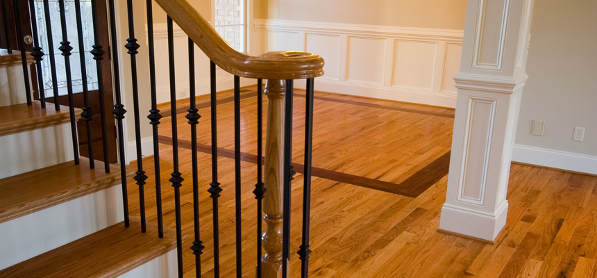 Quebe Flooring | About Us | Oak Hardwood Installation with Inlay